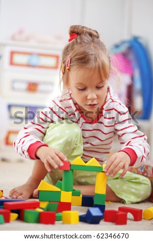 Child playing with blocks in the kindergarten - stock photo