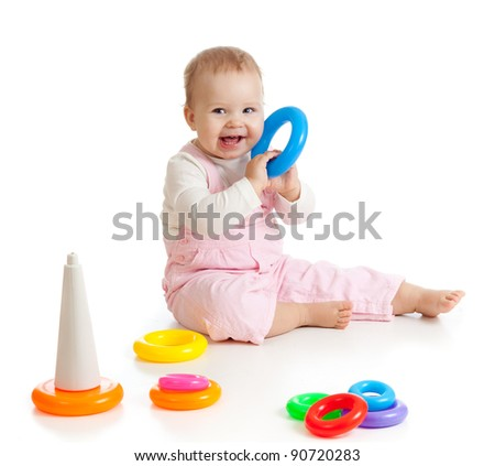 child playing with color pyramidion - stock photo