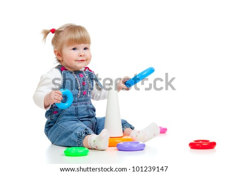 child playing with colour toy pyramid