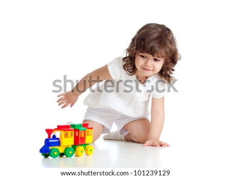 child playing  with colourful toy. Isolated on white background - stock photo