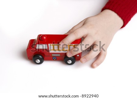 child playing with fire department toy truck
