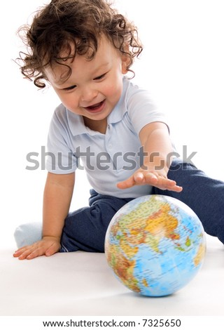 Child playing with globe,on a white background.