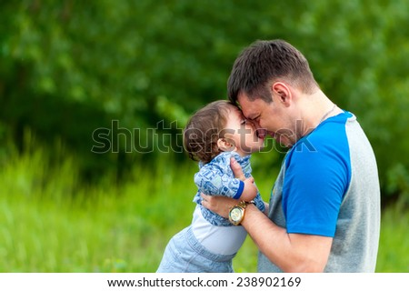 Child playing with his father on the street. Happy child. Kid and father.
