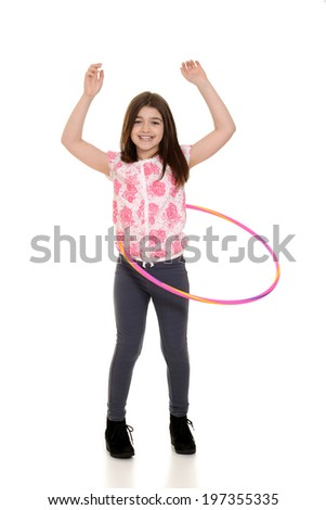 child playing with hula hoop - stock photo