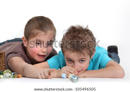 Child playing with marbles - stock photo