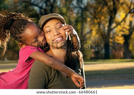Child playing with mother - stock photo