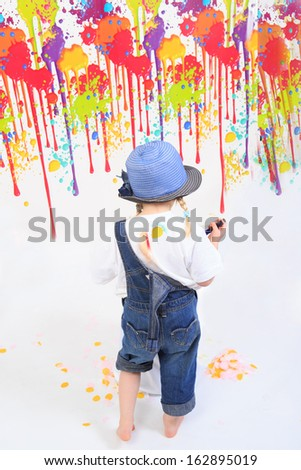 Child playing with paint - stock photo