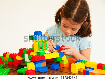 Child playing with plastic construction - stock photo