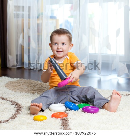 Child playing with toy at home