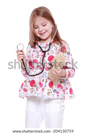 child playing with toy over white background - stock photo