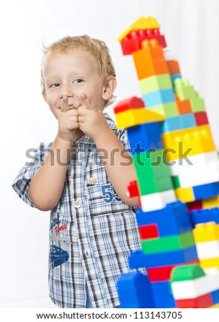 Child playing with toys - stock photo