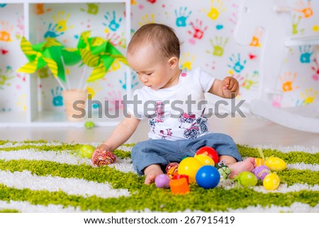 child playing with toys on the floor in the room - stock photo