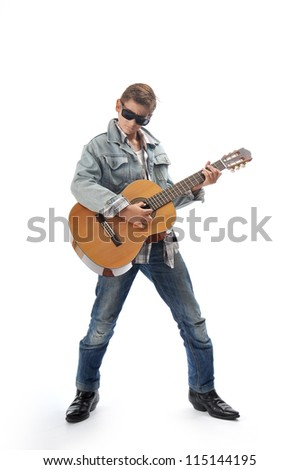 Child plays guitar