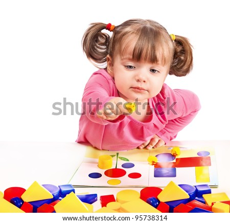 child plays in developing games - stock photo
