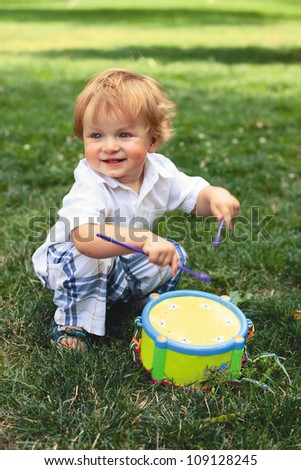 child plays on a drum - stock photo