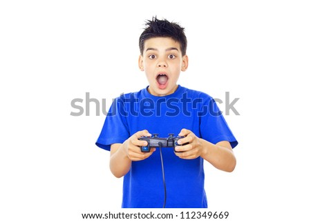 child plays video games on the joystick - stock photo
