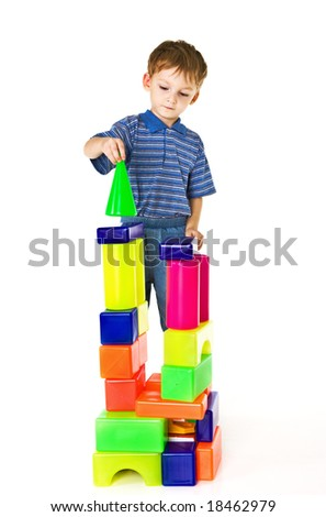 Child plays with color blocks - stock photo
