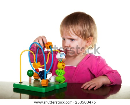 child plays with colorful education wooden toy - stock photo