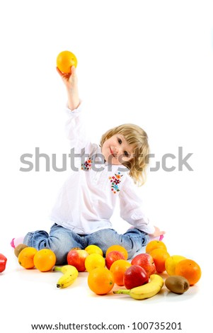 Child plays with fruit - stock photo