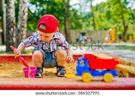 child plays with sand  - stock photo