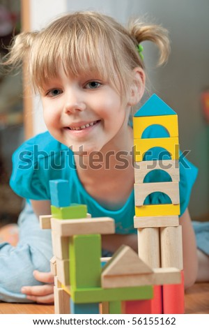 child plays with toy blocks - stock photo