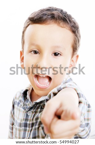 Child pointing and looking at the camera. White background