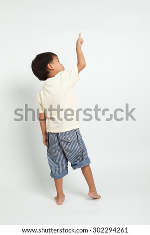 child pointing at side. Back view. Isolated on white background - stock photo