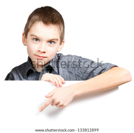 Child pointing his finger on blank white board - stock photo