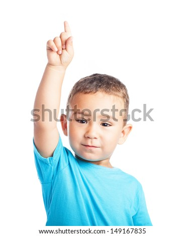 child pointing up with the finger on a white background - stock photo