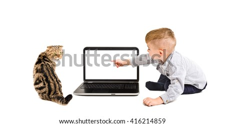 Child points finger at the screen of laptop sitting with a cat isolated on a white background - stock photo