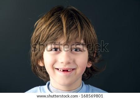 child portrait shot against grey background  - stock photo