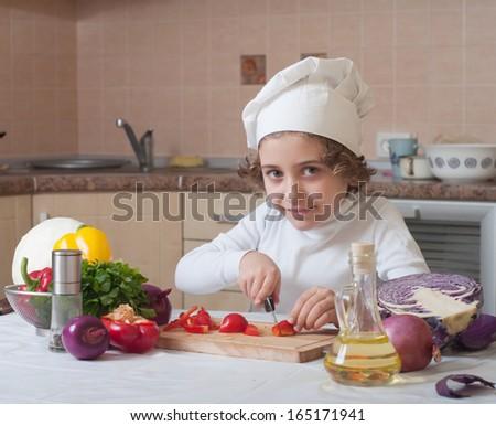 child preparing healthy food vegetable salad - stock photo
