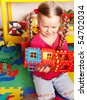 Child  preschooler play block and construction set in playroom. - stock photo