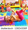 Child  preschooler playing with building block . - stock photo