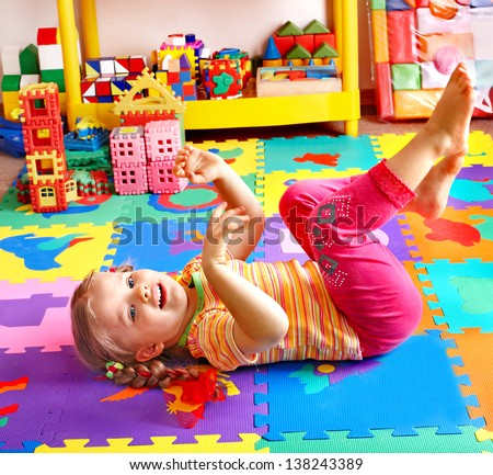 Child  preschooler playing with building block .