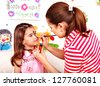 Child preschooler with face painting. Child care. - stock photo