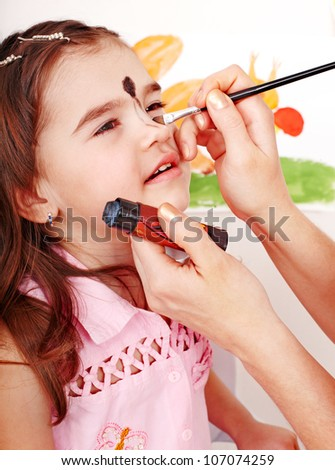 Child preschooler with face painting. Make up. - stock photo