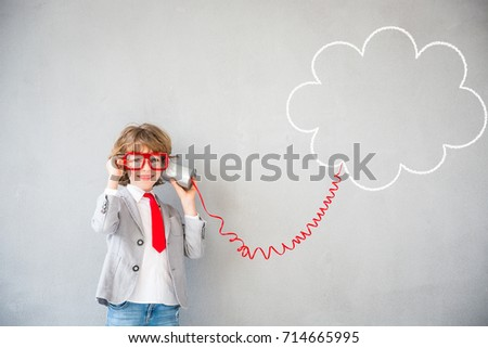 Child pretend to be businessman. Kid playing at home. Imagination, idea and success concept