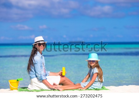 Child protection sun cream - stock photo