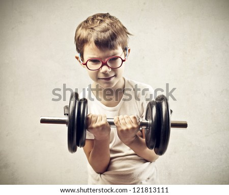 Child raising a dumbbell - stock photo