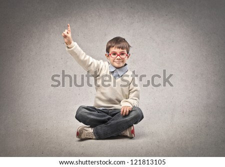 Child raising his right hand - stock photo