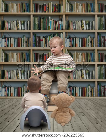 child reading a book in the library and teddy bear - stock photo