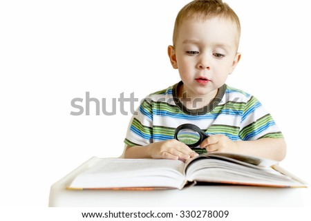 child reading a book with a magnifying glass. boy sitting in a high chair and reading a book. holding in a hand magnifying glass. Isolated on white background