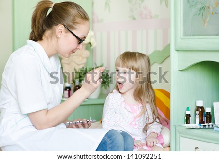 Child receiving pill - stock photo