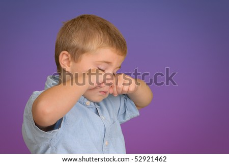 Child Rubbing His Eyes - stock photo