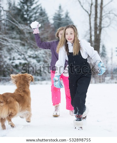 Child running in fear of impending snowball fight