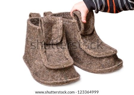 ... and large felt boots isolated on white background - stock photo