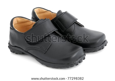 Child's black shoes on a white background