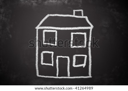 Child's chalk drawing of a house. Simple blackboard sketch. - stock photo