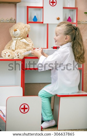 child's doctor examines a teddy bear